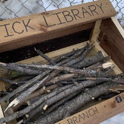 father-and-son-build-stick-library-for-local-dogs-to-borrow-sticks